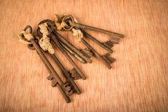 Bunch of old keys. Bunch of vintage oxidized keys with a strong patina Stock Photography