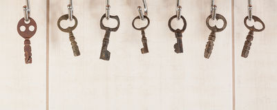Bunch of old keys hanging on wall Royalty Free Stock Photography