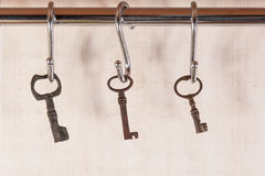 Bunch of old keys hanging on wall Stock Photos