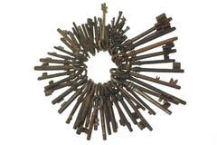 Bunch of old keys isolated on white background. Bunch of old fashioned skeleton keys isolated on white background Royalty Free Stock Photo