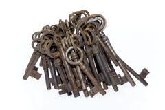 Bunch of old keys isolated on white background. Bunch of old fashioned skeleton keys isolated on white background Stock Photo