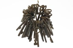 Bunch of old keys isolated on white background. Bunch of old fashioned skeleton keys isolated on white background Royalty Free Stock Photos