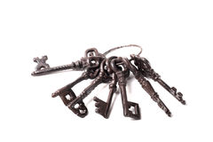 Bunch of old keys on a light background Stock Photography
