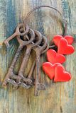 Bunch of old keys and red hearts. Stock Photos