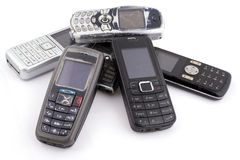 Bunch of old mobile phones. Isolated Stock Image