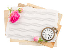 Bunch of old note papers with  antique clock Stock Photos