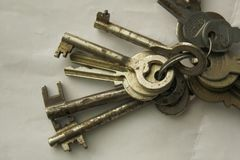 Bunch of old rusty keys of various size on a key-ring stock image