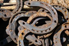 A bunch of old, rusty metal horseshoes. royalty free stock photo