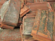 A bunch of old tiles. Old tiles stacked in a pile royalty free stock photography
