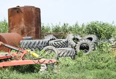 A bunch of old tires from tractor wheels. Protectors from the wheels of combine harvesters and tractors. A bunch of old tires from tractor wheels. Protectors Royalty Free Stock Photography