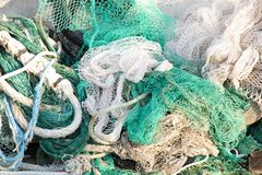 Bunch of old weathered trawl fishing net. Background stock images