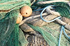 Bunch of old weathered trawl fishing net. Background royalty free stock photography