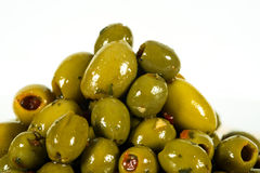 A Bunch of olives for the eating. OLIVES ON A PLATE WITH HERBS with Peppers Stock Images