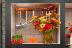 Bunch of orange flowers in kitchen interior Stock Images
