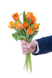 Bunch of orange flowers in male hand isolated on white Royalty Free Stock Image