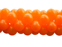 A bunch orange party balloons isolated Stock Image