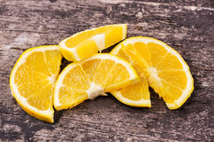 Bunch of orange slices on wood background Royalty Free Stock Photography