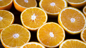 Bunch of oranges cut into half. Oranges cut in half on a table royalty free stock image