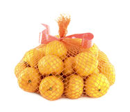 A bunch of oranges packaged. In netting Stock Photography