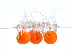 Oranges splashing in water Stock Photography