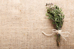 Bunch of organic thyme on burlap background Stock Photography