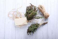 Bunch of organic thyme with twine on wooden background Royalty Free Stock Photos