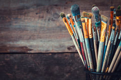 Bunch of paint brushes in a artist studio. Royalty Free Stock Photos