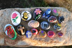 Bunch of painted rocks on a bigger boulder Stock Photo