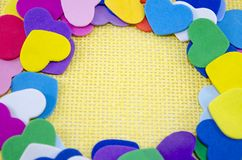Bunch of paper hearts on a yellow background Stock Photo