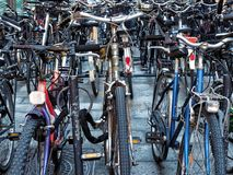 Bunch of parked bikes bicycles. Bunch of parked bikes or bicycles Royalty Free Stock Photos