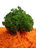 Bunch of parsley and cut carrot. On white background Royalty Free Stock Image