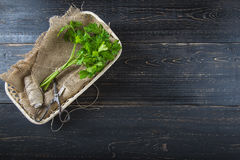 Bunch of parsley on dark wooden background Stock Photo