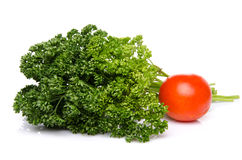 Bunch of parsley with a tomato Royalty Free Stock Photo