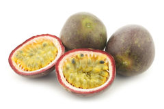 Bunch of passion fruits and a cut one Stock Photo
