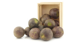 Bunch of passion fruits in a wooden box Stock Image