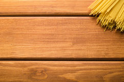 Bunch of pasta on brown wooden table Stock Photo