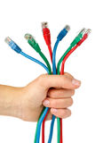 Bunch of patch-cords gripped in fist Royalty Free Stock Image