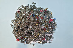 A bunch of pc screws and bolts stock photos