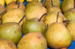 A bunch of Pears on the table in the market. Novi Sad, Serbia royalty free stock photo