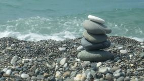 Bunch of pebbles on the coast stock footage