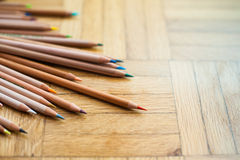 Bunch of pencil with wooden body on parquet background Royalty Free Stock Photos