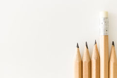 Bunch of pencils one with eraser up standing out Royalty Free Stock Image