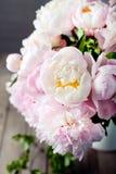 Bunch of peony flowers  in an enamel jar Stock Photo