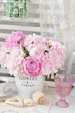 Bunch of peony in shabby chic style interior Royalty Free Stock Photography