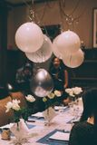 Wen celebrity birthday party in shanghai. A bunch of people at a  birthday party at old house in shanghai, The ballin and wine glasses and white rose and cake stock images