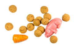 Bunch of Pepernoten cookies with marzipan pig and carrot Royalty Free Stock Photos