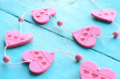 Bunch of pink decorative hearts on shabby blue background Royalty Free Stock Photos