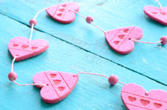 Bunch of pink decorative hearts on shabby blue background Royalty Free Stock Images