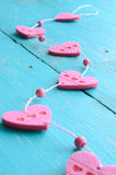 Bunch of pink decorative hearts on shabby blue background Royalty Free Stock Photo