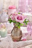 Bunch of pink flowers in vase on the table in shabby chic style Royalty Free Stock Image